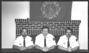 L to R:   (1997) Safety Officer Joe Eggemeier, Asst. Chief Mike O'Day, Fire Chief Denny Lynn